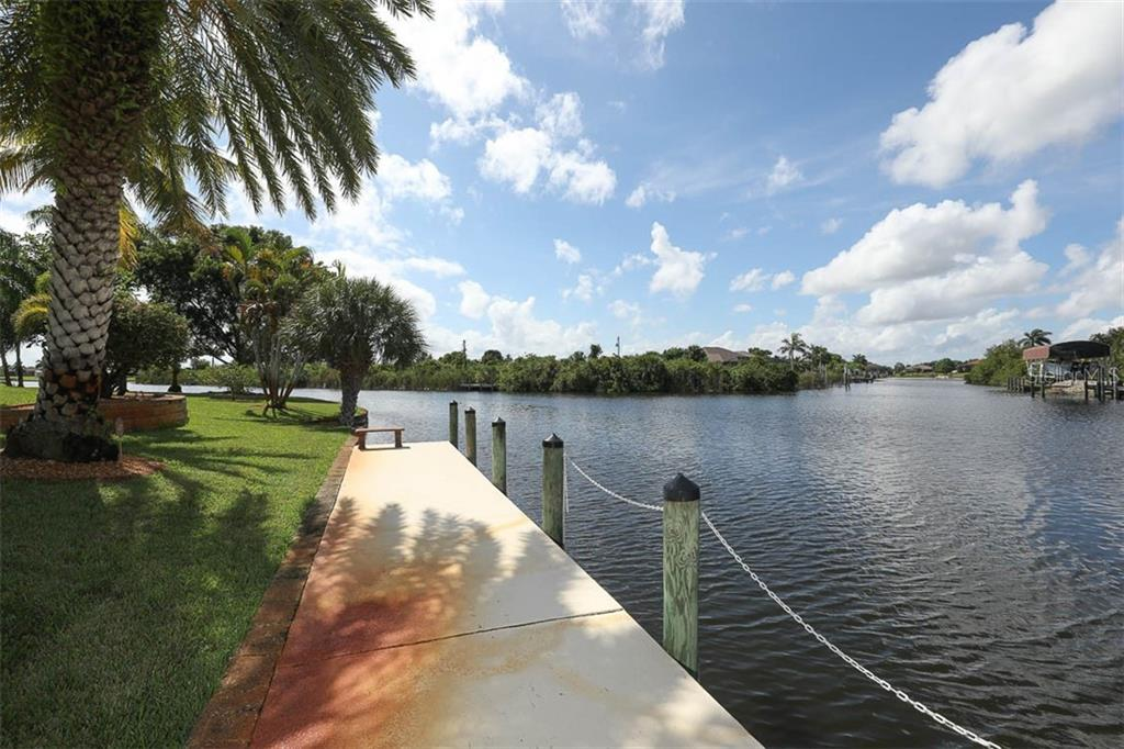 Dock and Water Views - Single Family Home for sale at 9300 Hialeah Ter, Port Charlotte, FL 33981 - MLS Number is D6113597