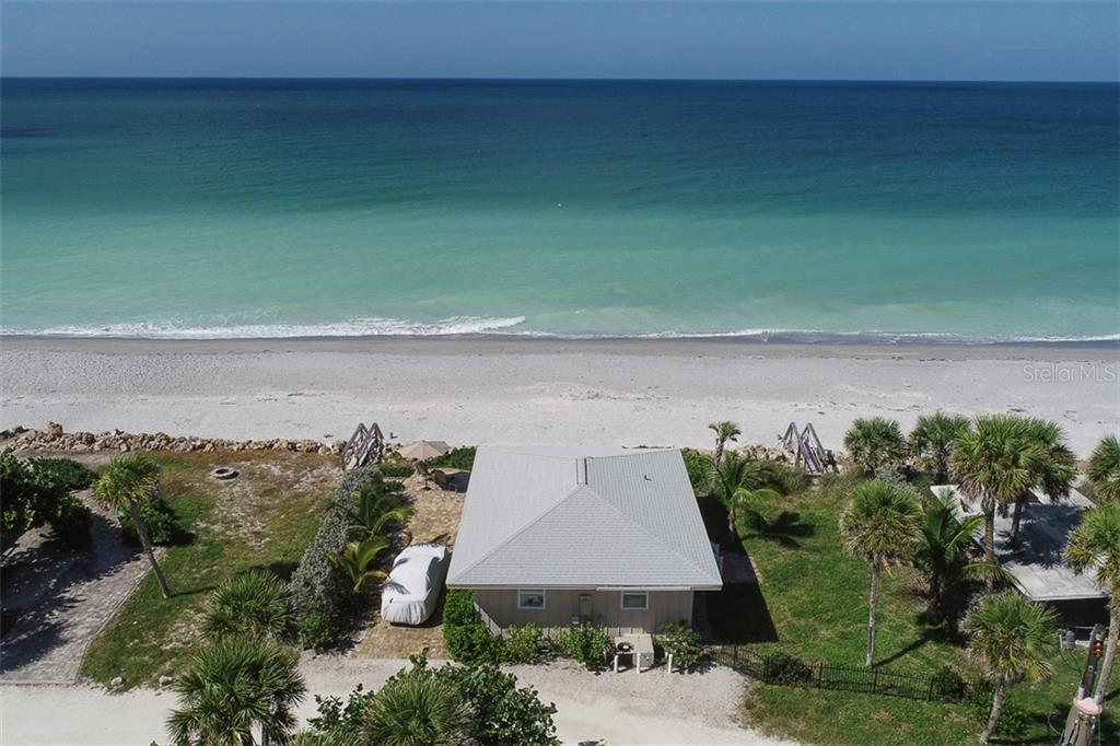 Aerial of the house, beach, gulf and paver patio - Single Family Home for sale at 4074 N Beach Rd #Ctg4, Englewood, FL 34223 - MLS Number is D6114111