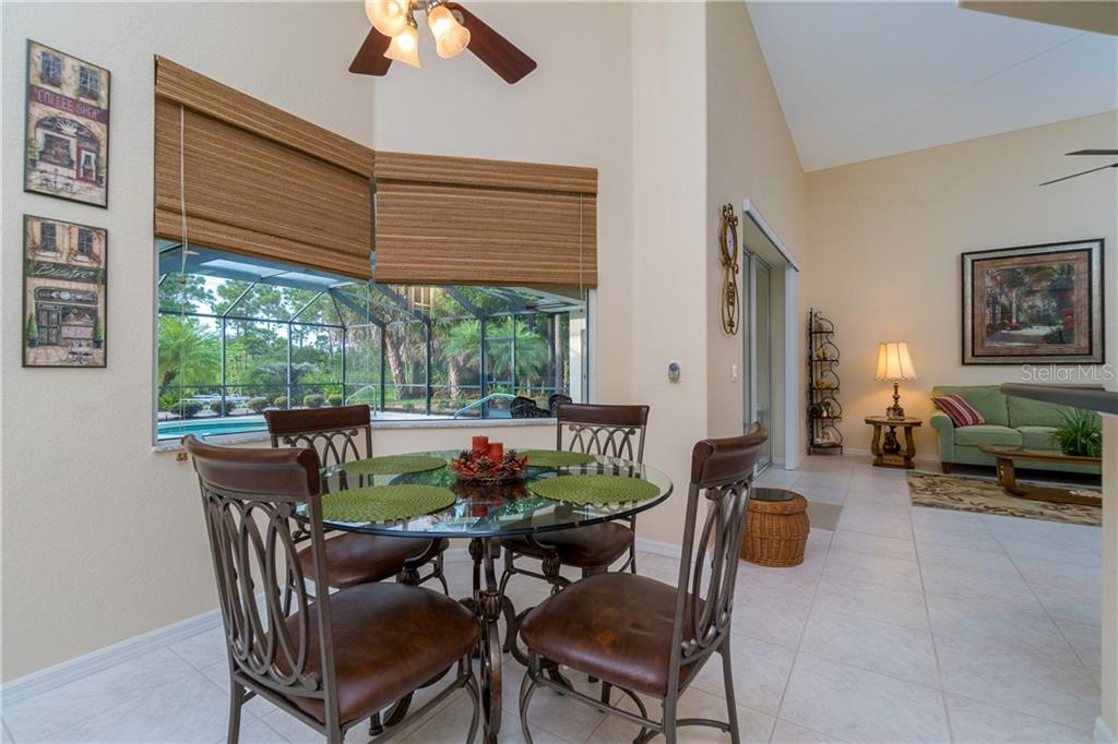 Breakfast nook has aquarium window view of the lanai/pool area. - Single Family Home for sale at 439 Boundary Blvd, Rotonda West, FL 33947 - MLS Number is D6114162