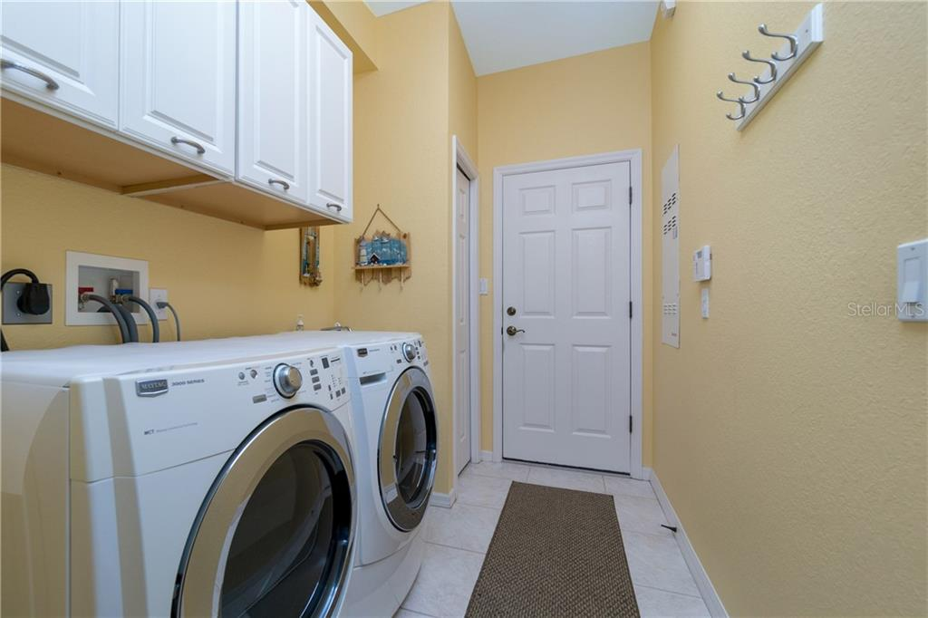 Laundry room has plenty of storage and utility sink. - Single Family Home for sale at 439 Boundary Blvd, Rotonda West, FL 33947 - MLS Number is D6114162