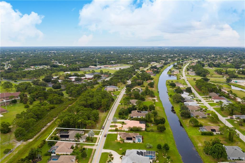 Aerial view 2 - Single Family Home for sale at 439 Boundary Blvd, Rotonda West, FL 33947 - MLS Number is D6114162