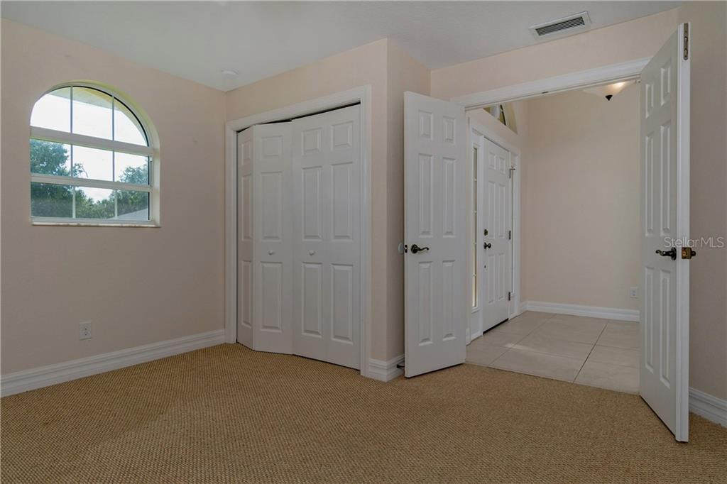 ANOTHER LOOK AT BEDROOM # 3 WITH A DOUBLE DOOR ENTRY.  THIS IS THE BEDROOM NEAR THE FRONT ENTRANCE. - Single Family Home for sale at 112 Boxwood Ln, Rotonda West, FL 33947 - MLS Number is D6114179