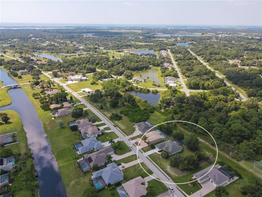 Vacant lot to the right of the home, included in the circle, is available for additional cost. - Single Family Home for sale at 427 Boundary Blvd, Rotonda West, FL 33947 - MLS Number is D6114396