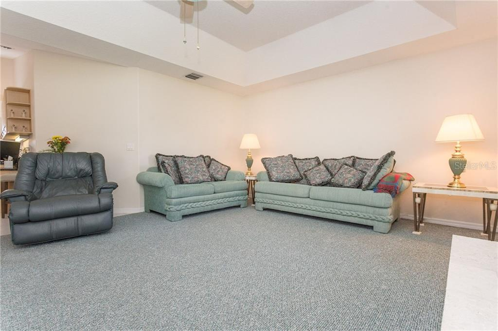 Family room is large enough to hold a crowd - Single Family Home for sale at 1720 Larson St, Englewood, FL 34223 - MLS Number is D6114414