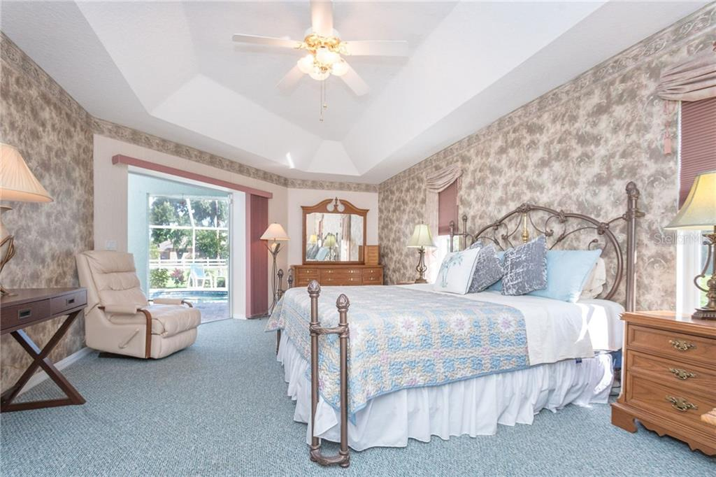 Large master bedroom has private access to the lanai - Single Family Home for sale at 1720 Larson St, Englewood, FL 34223 - MLS Number is D6114414