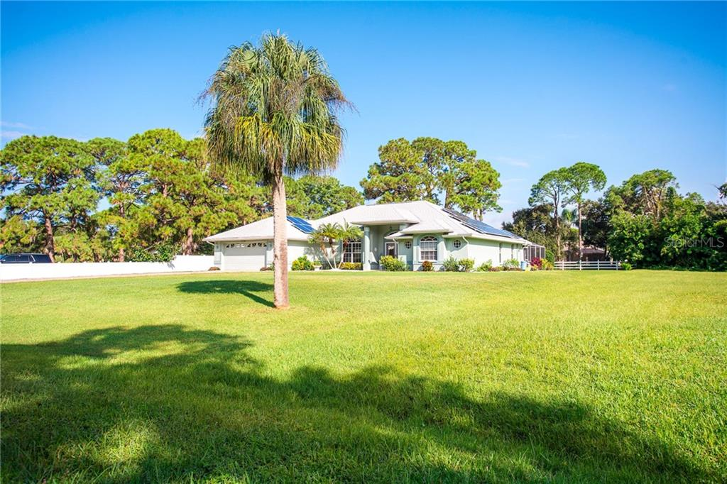 Peaceful setting just minutes to Manasota Beach, The Brave's stadium and more. - Single Family Home for sale at 1720 Larson St, Englewood, FL 34223 - MLS Number is D6114414
