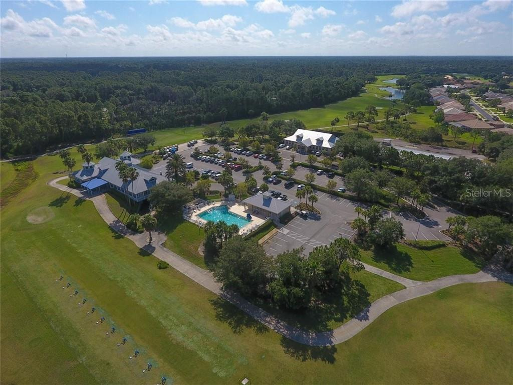 AERIAL VIEW OF POOL,  CLUB HOUSE AND COMMUNITY CENTER - Single Family Home for sale at 1944 Coconut Palm Cir, North Port, FL 34288 - MLS Number is D6114523
