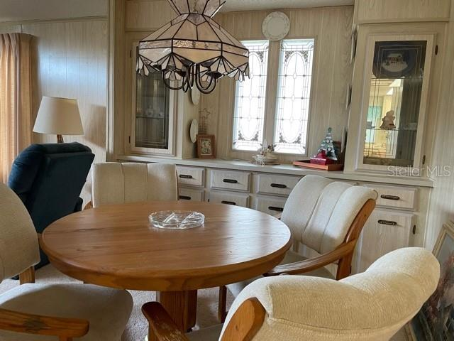 Dining room - Manufactured Home for sale at 6384 Kilepa Ct, North Port, FL 34287 - MLS Number is D6114877