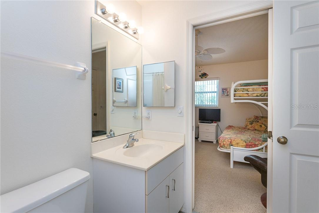Bathroom 2 with direct access from bedroom 2 to give your guests added privacy - Condo for sale at 6610 Gasparilla Pines Blvd #229, Englewood, FL 34224 - MLS Number is D6117434