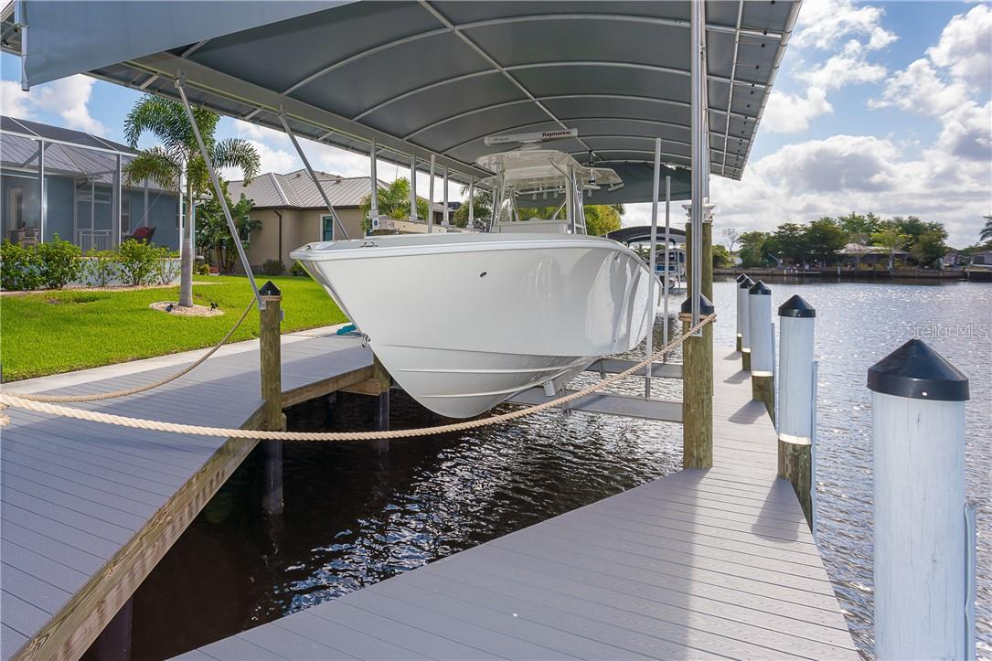 New 16,000 lb covered boat lift surrounded by a new walk-around dock with water & electric with a brand new concrete seawall just seconds out to big water with no bridges. What more could you ask for? - Single Family Home for sale at 145 Leland St Se, Port Charlotte, FL 33952 - MLS Number is D6117438