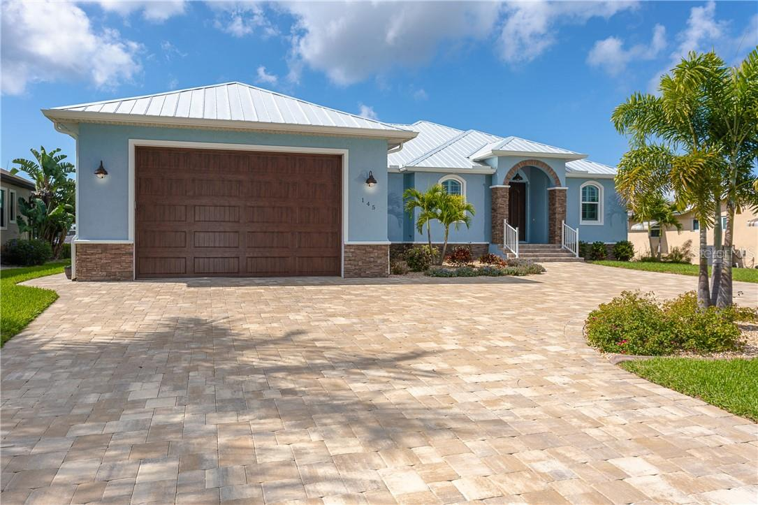 Beautifully landscaped with irrigation system for easy care - Single Family Home for sale at 145 Leland St Se, Port Charlotte, FL 33952 - MLS Number is D6117438