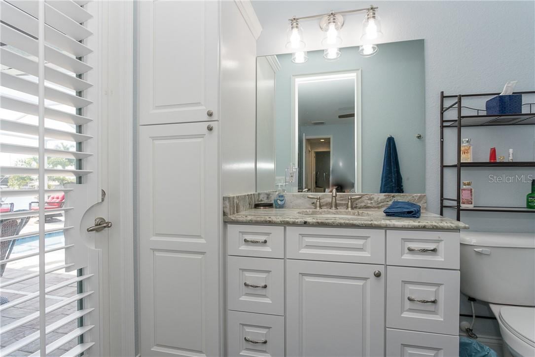 Bathroom 3 with lots of storage space and direct access to the lanai and plantation shutters for additional privacy - Single Family Home for sale at 145 Leland St Se, Port Charlotte, FL 33952 - MLS Number is D6117438