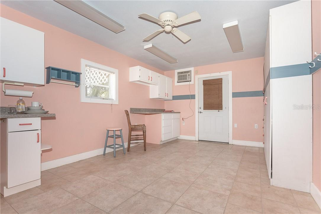 Space in Garage for a studio - Single Family Home for sale at 1661 New Point Comfort Rd, Englewood, FL 34223 - MLS Number is D6117712