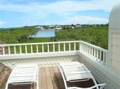 looking toward Lemon Bay from 3rd floor sundeck - Single Family Home for sale at 9711 Eagle Preserve Dr, Englewood, FL 34224 - MLS Number is D5796719