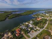 Single Family Home for sale at 285 Green Dolphin Dr, Placida, FL 33946 - MLS Number is D5908965