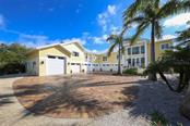 Front Entrance - Single Family Home for sale at 7295 Manasota Key Rd, Englewood, FL 34223 - MLS Number is D5911936