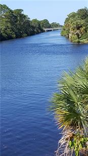 Water view from Cocoplum Waterway - Vacant Land for sale at Brickell Dr, North Port, FL 34286 - MLS Number is D5913554