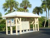 Mailbox area for all Eagle Preserve Estates residents where they can receive their U. S Mail and read notifications about community meetings and events on the community bulletin board. - Vacant Land for sale at 9980 Eagle Preserve Dr, Englewood, FL 34224 - MLS Number is D5917467