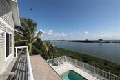 View from sun deck off master - Single Family Home for sale at 16740 Grande Quay Dr, Boca Grande, FL 33921 - MLS Number is D5920860