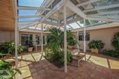 Clubhouse atrium - Condo for sale at 11000 Placida Rd #309, Placida, FL 33946 - MLS Number is D5921681