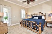 Master bedroom with access to lanai - Single Family Home for sale at 8944 Scallop Way, Placida, FL 33946 - MLS Number is D5923173
