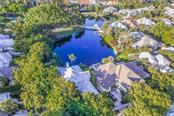 Aerial view of home and lake - Single Family Home for sale at 186 Carrick Bend Ln, Boca Grande, FL 33921 - MLS Number is D5923688