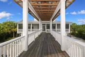 Covered Walkway to Guest House - Single Family Home for sale at 6100 Palm Point Way, Placida, FL 33946 - MLS Number is D6102528