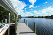 Dock - Single Family Home for sale at 121 Bocilla Dr, Placida, FL 33946 - MLS Number is D6102584
