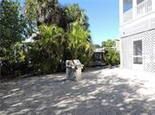 Rear of Home with Grill. - Single Family Home for sale at 111 Kettle Harbor Dr, Placida, FL 33946 - MLS Number is D6104218