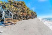 The rock wall is a revetment, a method of hardening the shore to protect the shoreline. - Single Family Home for sale at 7400 Manasota Key Rd, Englewood, FL 34223 - MLS Number is D6104362