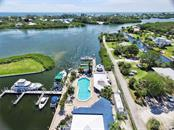 Spacious Lanai overlooking the marina & intercoastal waterways - Condo for sale at 7070 Placida Rd #1126, Cape Haze, FL 33946 - MLS Number is D6107781