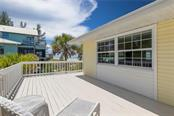Deck Facing East over Gardens - Single Family Home for sale at 8 Adele Way, Placida, FL 33946 - MLS Number is D6108747