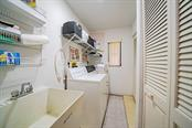 laundry room - Single Family Home for sale at 408 Seasons Dr, Port Charlotte, FL 33983 - MLS Number is D6113303