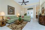 Formal living room with volume ceiling presents a feeling of light and bright as soon as you walk in! - Single Family Home for sale at 439 Boundary Blvd, Rotonda West, FL 33947 - MLS Number is D6114162