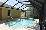 LOVELY SCREENED POOL AREA. - Single Family Home for sale at 112 Boxwood Ln, Rotonda West, FL 33947 - MLS Number is D6114179