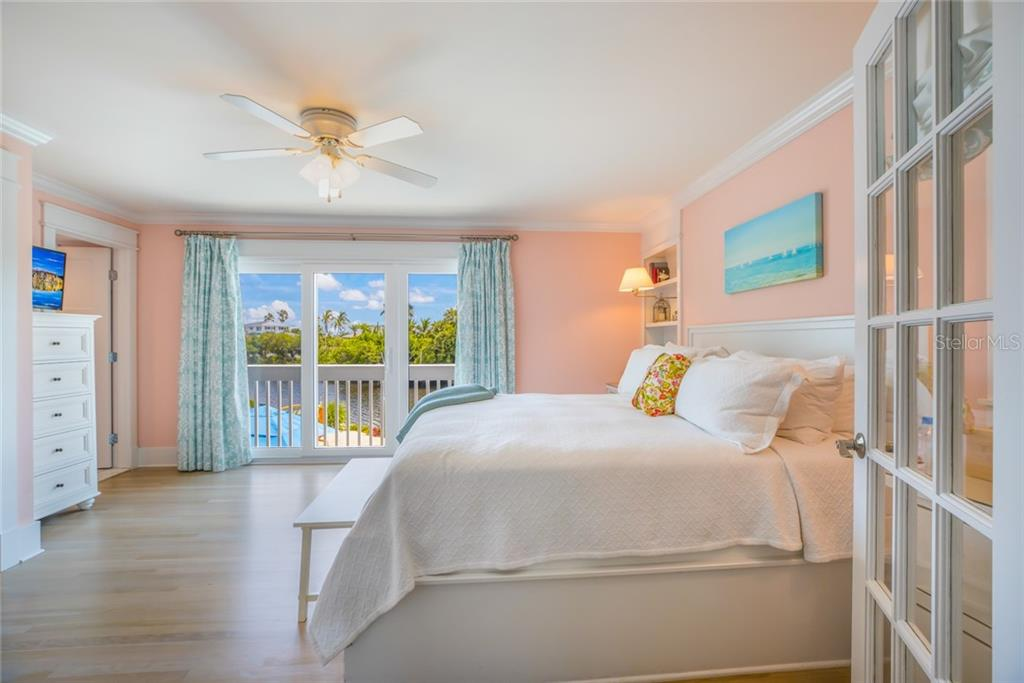 A built-in King Bed with custom drawers is found in the main floor master suite - Single Family Home for sale at 511 Loquat Dr, Anna Maria, FL 34216 - MLS Number is T3196169