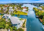 Over 130 feet of canal frontage with concrete seawall, composite dock and kayak lift - Single Family Home for sale at 511 Loquat Dr, Anna Maria, FL 34216 - MLS Number is T3196169