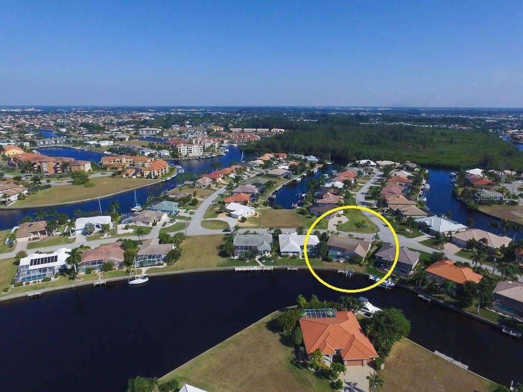 Wide intersecting canal view.  Enjoy western sunsets - this is Florida living at it's best - Single Family Home for sale at 3419 Sandpiper Dr, Punta Gorda, FL 33950 - MLS Number is C7232529