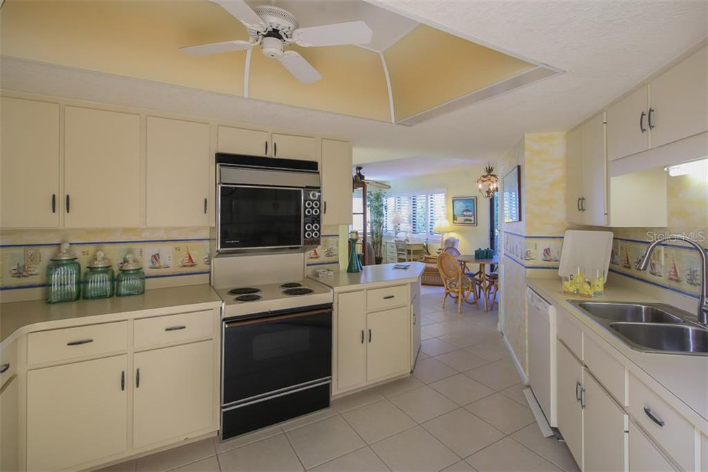 Spacious kitchen leads to the family room - Condo for sale at 1765 Jamaica Way #302, Punta Gorda, FL 33950 - MLS Number is C7234643