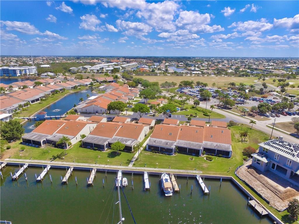 Villa #24 is to the left of the walkway in this photo, making it an end unit with only one shared wall.  Dock #9 is just steps from the lanai - Villa for sale at 1890 Deborah Dr #24, Punta Gorda, FL 33950 - MLS Number is C7237753