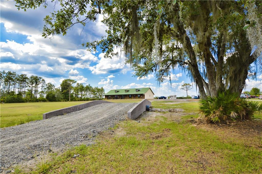 Path to Front of home (Stepping Stones to walk from parking area to front porch) - Single Family Home for sale at 30720 Washington Loop Rd, Punta Gorda, FL 33982 - MLS Number is C7239690