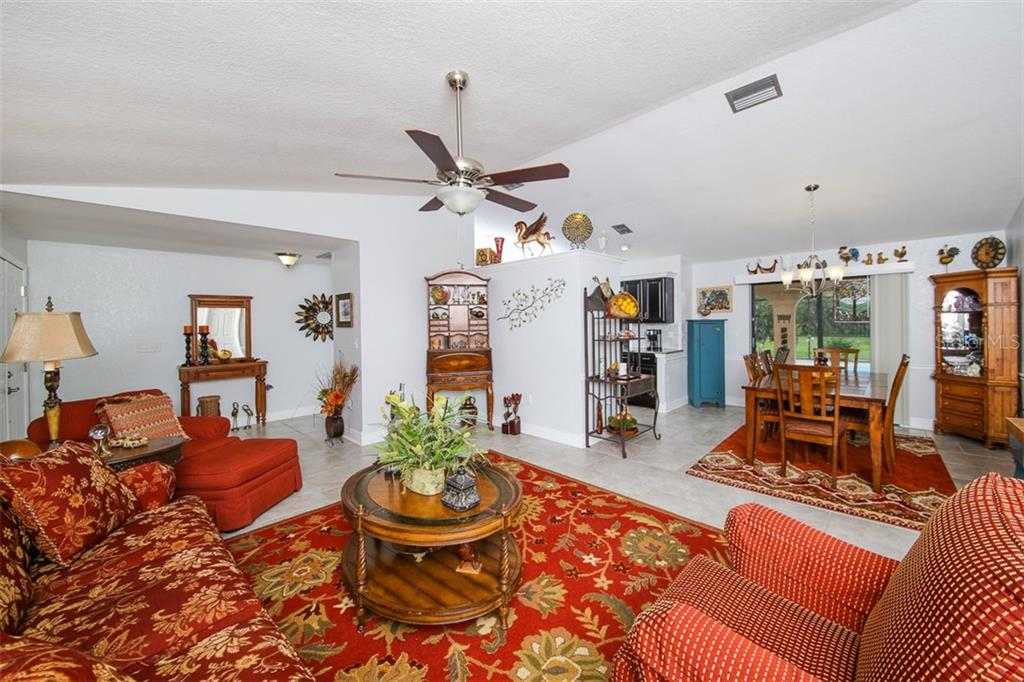 Charming living room/dining room - Single Family Home for sale at 26178 Rampart Blvd, Punta Gorda, FL 33983 - MLS Number is C7240559