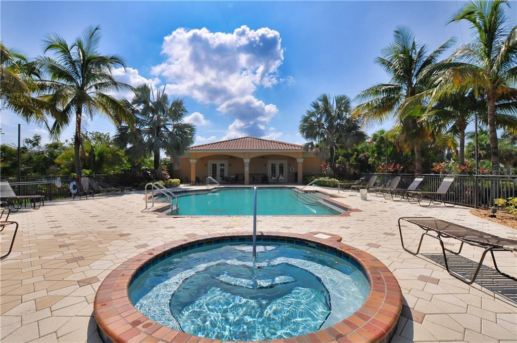 Spa and pool overlooking club house - Condo for sale at 95 N Marion Ct #136, Punta Gorda, FL 33950 - MLS Number is C7243837