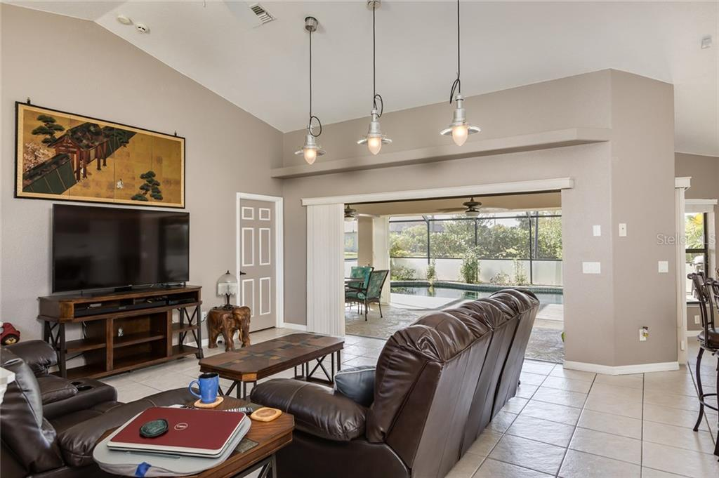 Open floor plan - Kitchen/Dining/Living Room - Single Family Home for sale at 515 Royal Poinciana Cir, Punta Gorda, FL 33955 - MLS Number is C7244338