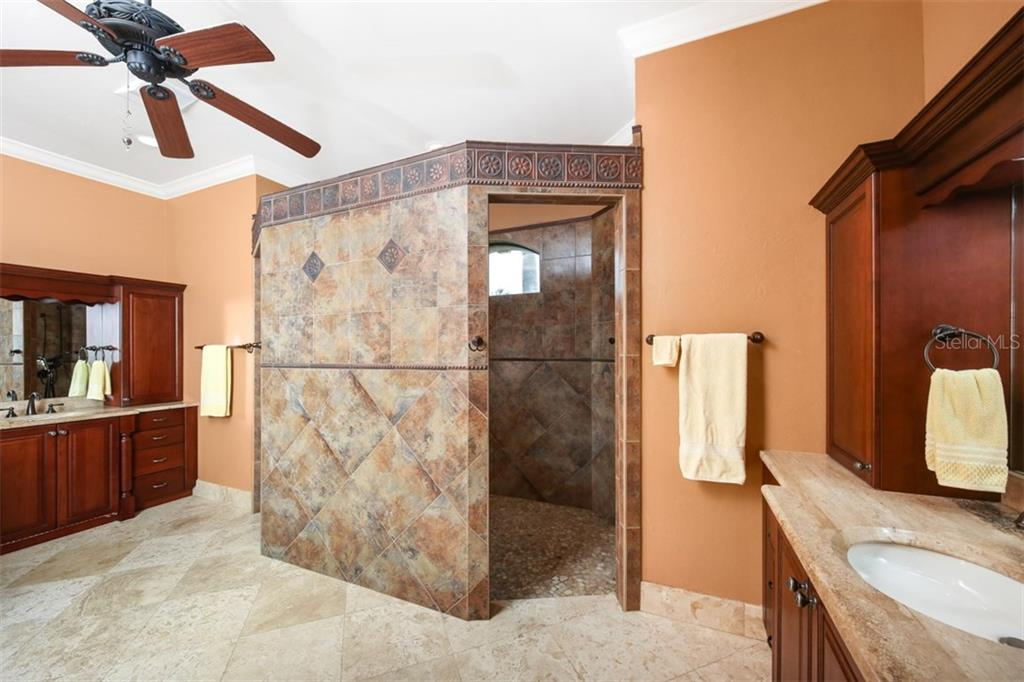 Spacious bath with his & her vanities, cherry cabinetry and drawer storage, toe kick lighting, stone counters, private commode and dual head walk through shower.  Lavish to say the least! - Single Family Home for sale at 17208 Barcrest Ln, Punta Gorda, FL 33955 - MLS Number is C7245458