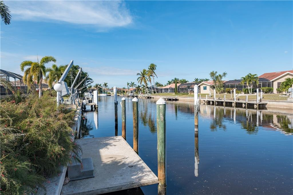 59' concrete seawall with concrete dock. - Single Family Home for sale at 2510 Rio Largo Ct, Punta Gorda, FL 33950 - MLS Number is C7246934