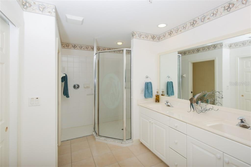 Master bath enjoys a private commode, walk-in shower, dual sinks along with a combination of cabinet and drawer storage.  Yes, you will find this residence has excellent storage options! - Condo for sale at 3392 Sunset Key Cir #b, Punta Gorda, FL 33955 - MLS Number is C7249092