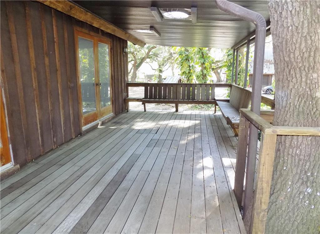 Main House front porch - Single Family Home for sale at 5624 Reisterstown Rd, North Port, FL 34291 - MLS Number is C7250923