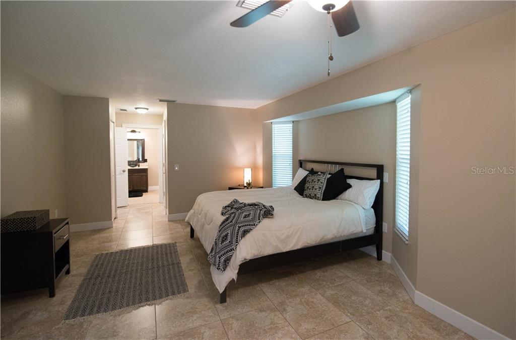 Your master ensuite invites you in to relax and enjoy, plus if you'd like to stroll out to the lanai or pool, you have your own private French-doors leading to the beautiful outdoors. - Single Family Home for sale at 3184 Ulman Ave, North Port, FL 34286 - MLS Number is C7400587