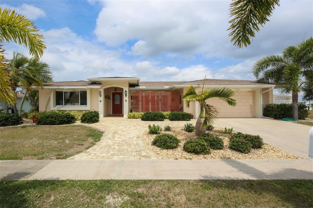 This home has massive curb appeal! - Single Family Home for sale at 158 Morgan Ln Se, Port Charlotte, FL 33952 - MLS Number is C7400633